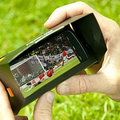 Orange phone sun visor gives football fans a clear view