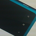 Nokia 703 Windows Phone 7 device pictured