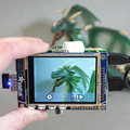 You can hack the Raspberry Pi into a touchscreen camera