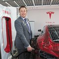 Tesla is making a car charger that automatically moves and looks like a 'solid metal snake'