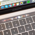 This Apple patent depicts a MacBook with a Touch Bar for the keyboard