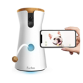 This awesome home pet camera lets you speak to your dog and throw out treats throughout the day
