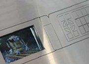 KDDI shows 3D mobile phone display - photo 2