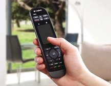 Logitech shows off the Harmony Touch TV remote, complete with mini touchscreen interface