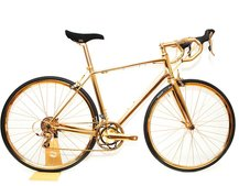 Behold the bicycle you will never ride: The £250K road bike covered in 24kt gold