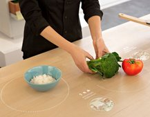 Ikea thinks in 2025 we'll be cooking on tables that project recipes and more