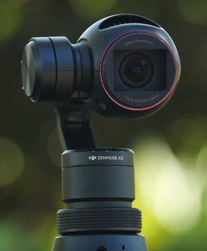 DJI Osmo is basically a pricey selfie stick that can shoot steady vids in 4K