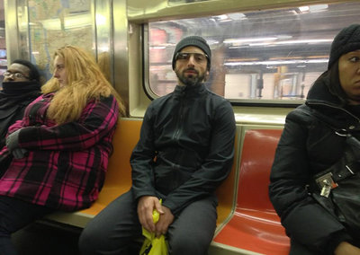 Google boss Sergey Brin snapped on New York subway going about his Google Glass business
