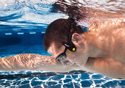 Finis Neptune lets you listen to music while swimming, using your cheekbones