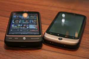 The HTC Desire (left) suspiciously eyes the Nexus One (right)