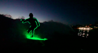 Surfing Tron takes to the waves to celebrate the summer (Video)