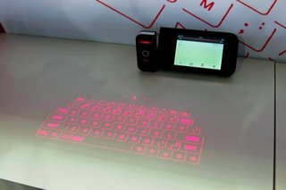 Prodigy projection keyboard iPhone case turns any surface into a keyboard