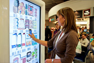 Tesco trials interactive virtual store at Gatwick Airport, for holidaymakers to pre-order groceries
