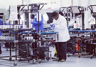 Motorola shows off US assembly line worker building a Moto X smartphone
