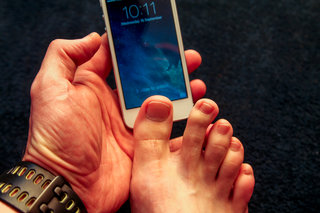 Yes, you can use your toes to open the new iPhone 5S