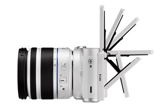 Samsung NX300M, it's an NX300 system camera with added adjustable 'selfie' screen