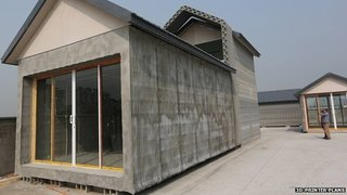 Ten houses 3D printed in 24 hours, construction workers look out