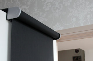 Qmotion Shades remote and app-controlled blinds, maintaining privacy from the comfort of a sofa