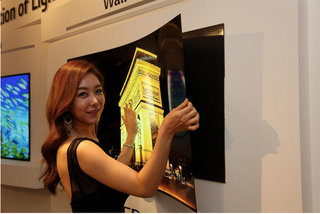 LG's new OLED TV is under 1mm thin, sticks to wall like a fridge magnet