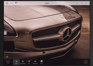 This is Adobe's mobile retouching app that will replace Photoshop Touch