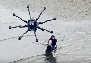 Drone surfing is here! This drone is so powerful it tows people on water