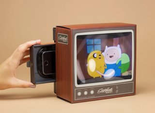 This nostalgic toy magnifies your phone vids onto a mini retro TV