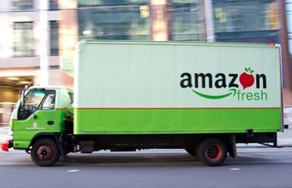 What is Amazon Fresh and where can you get grocery deliveries for free?