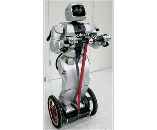 Photo: Korean robot rides a Segway