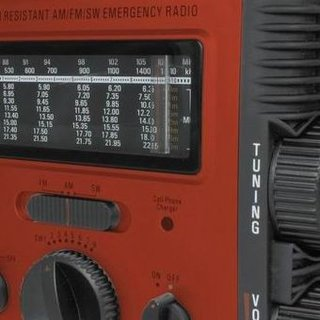 A self-powered radio, phone charger and torch all-in-one
