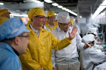 Apple promises to improve working conditions as Tim Cook visits China