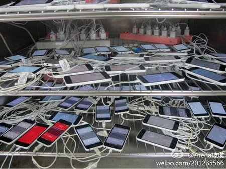 A pile of iPhone 5Cs caught charging at Pegatron, ahead of Apple's September event
