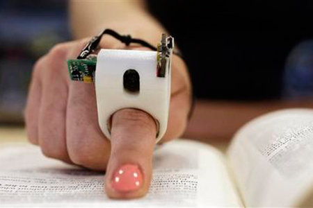 FingerReader is a ring that scans words and reads aloud to the user in real-time